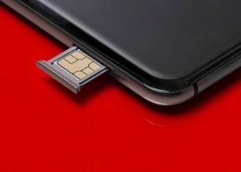 halodoc - close up of a smart phone and sim card on red background t20 QKZ1Kb - Halodoc Masuk dalam Daftar 150 Digital Health Paling Menjanjikan Dunia