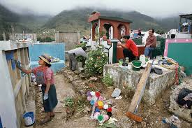 People in cemeteries all over Guatemala use the day to clean up the graves of family members, paint and decorate.