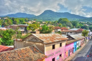 2. (Background) My name is Juana. I am 16 years-old and I live in Masaya, Nicaragua. I love my town. The houses are painted all the colors of the rainbow.