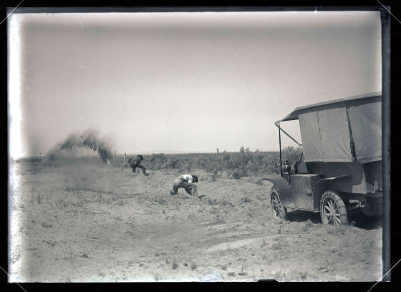 Bohlman and Peck Digging the Automobile from the Sand