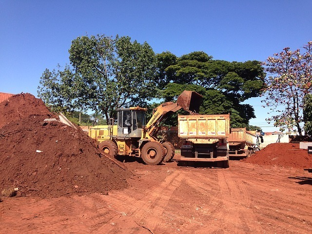 Bulldozer and heavy construction equipment equipment grading land