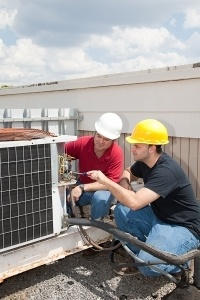 instructor teaching an apprenticeship how to service an AC unit