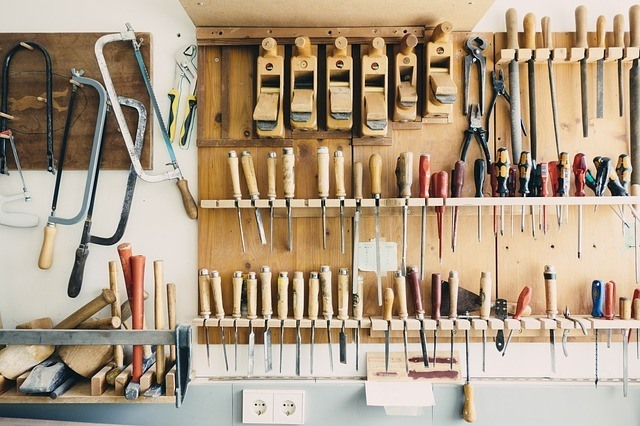wood shop with various tools hanging on a wall