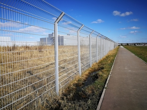Tall metal fence