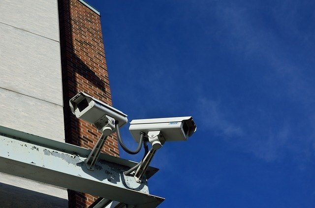 two security cameras mounted on a building