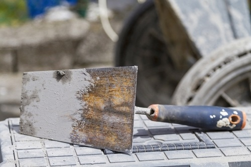 Tool covered in cement after paving process