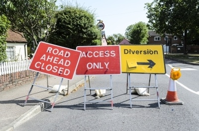 Signs indicating that there is a road closure for maintenance