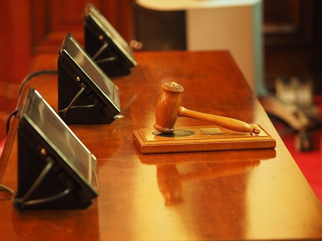court room desk with a wooden gavel