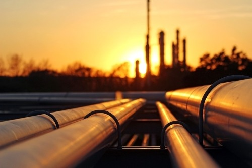 A pipeline with a sunset in the background