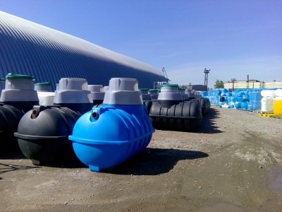 water treatment tanks outside at a treatment facility