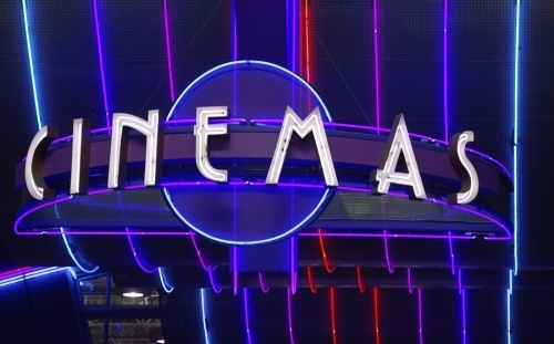A large purple neon sign with the words cinema in white. Sign for a movie theatre entrance. The C-45 license is the contractor license required in the state of california to bid on electrical and non electrical sign construction projects over $500