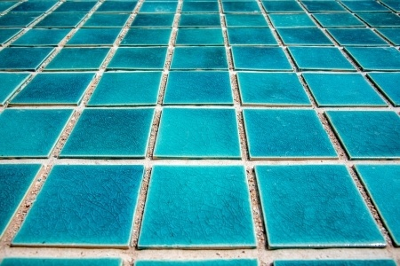 Blue tile that is used on swimming pools