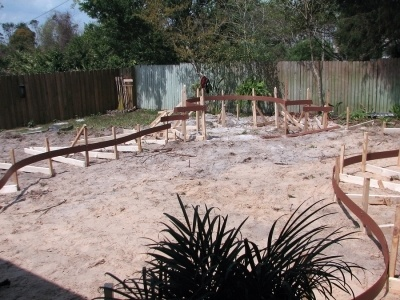 the beginning stages of a pool construction. Area of the pool is set with metal bars. journey level experience is required of anyone looking to get the C-53 license