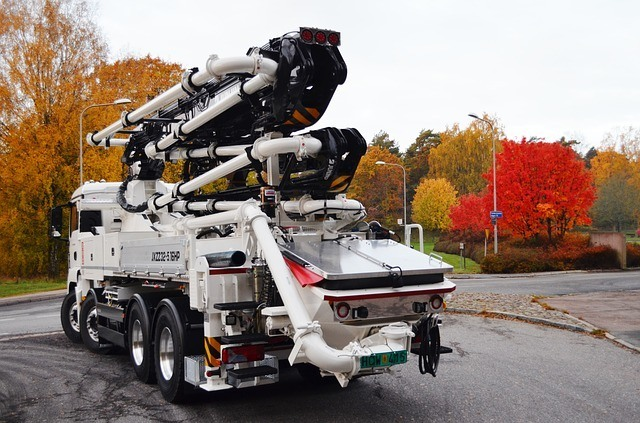 A new concrete pumping truck, parked outside