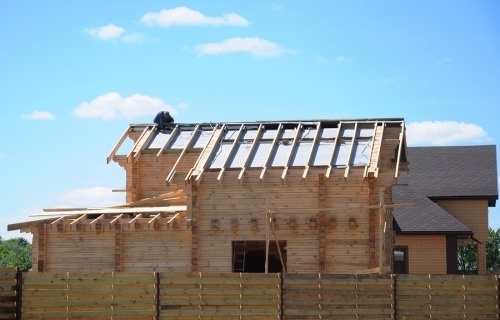 a residential home in the middle of the roofing process