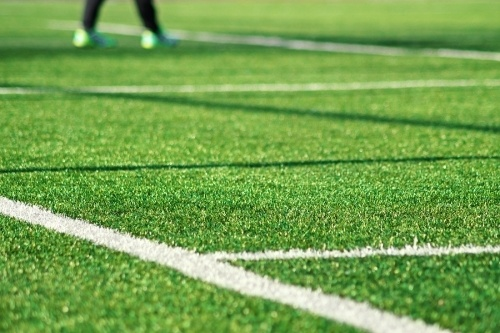 Green synthetic turf commonly found on soccer fields
