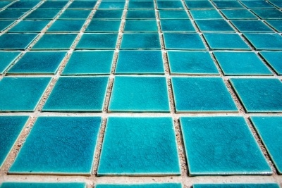 Blue tiles typically found at the bottom of a swimming pool