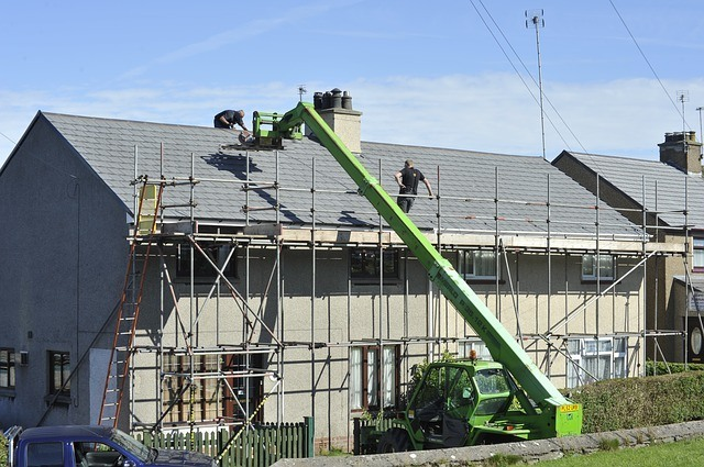 Scaffolds set up around a house fixing a roof