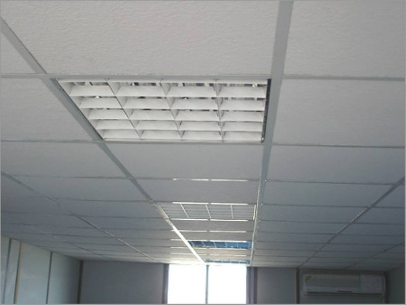A suspended ceiling system commonly found in an office building. A Suspended ceiling contractor works in a wide range of areas associated with ceilings
