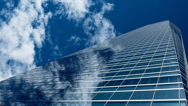 A large glass building facing the sky on a clear blue day. There are several lucrative career paths within the construction industry. Everything you are looking for begins with becoming a journeyman level tradesman