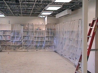 A library being contained with plastic wrap during the mold remediation process