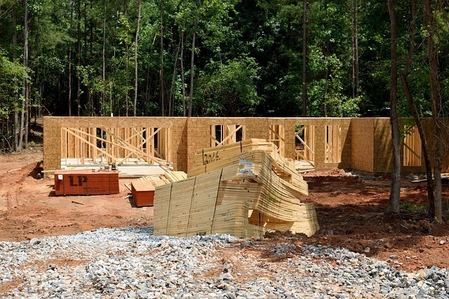 A house in the middle of the framing process. Owner builder experience can be used to get a general contractor license in California