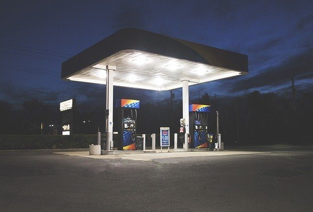 A gas station lit up at night time