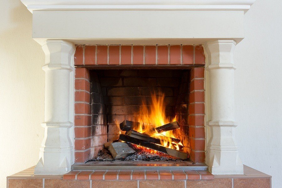 a fireplace with an active fire. passing the masonry license exam can be easy if you follow these 5 steps