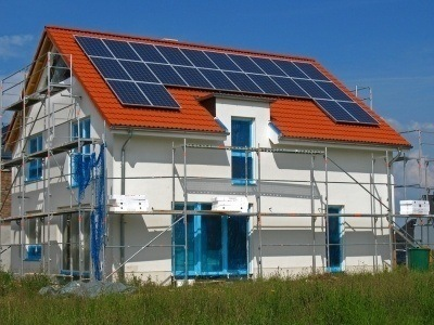 a house in the process of having solar panels installed