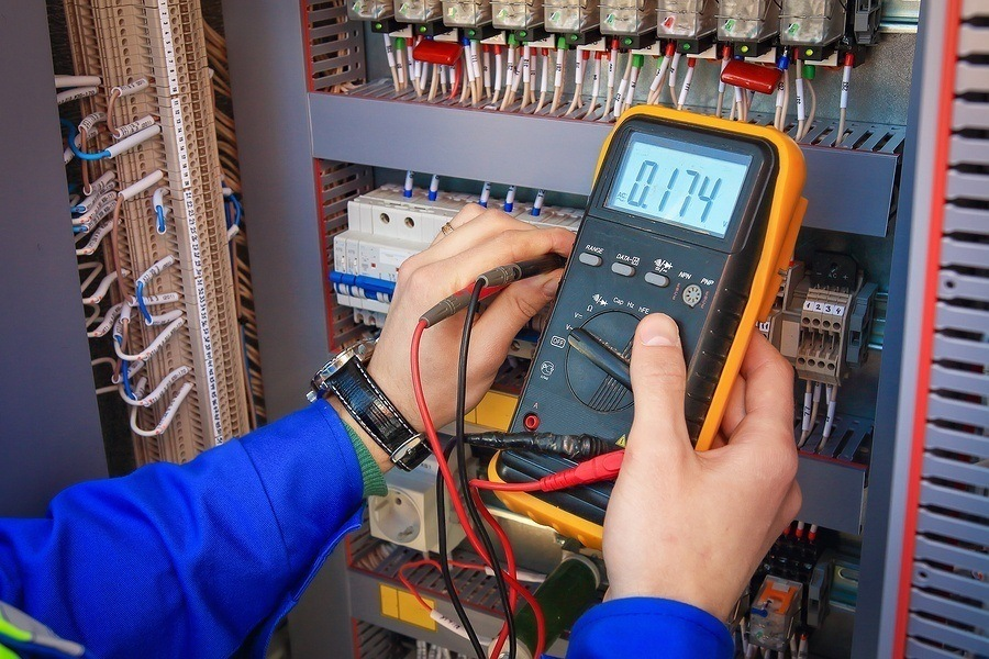 an electrician doing tests on a system. the utah electrical license is for master electricians