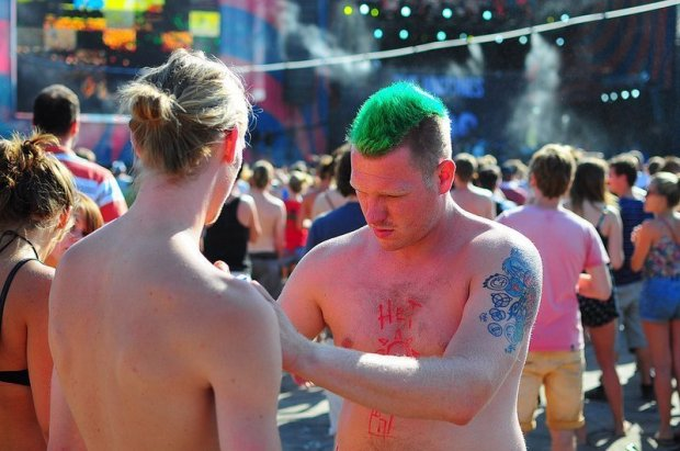 two punks helping each other out with some body paint
