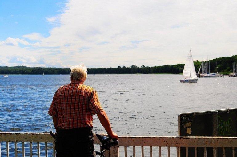 old man watching a boat spree berlin koepenick