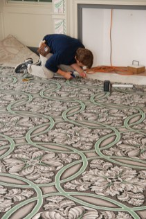 The Brussels weave carpet being installed in the Madison's Dining Room.