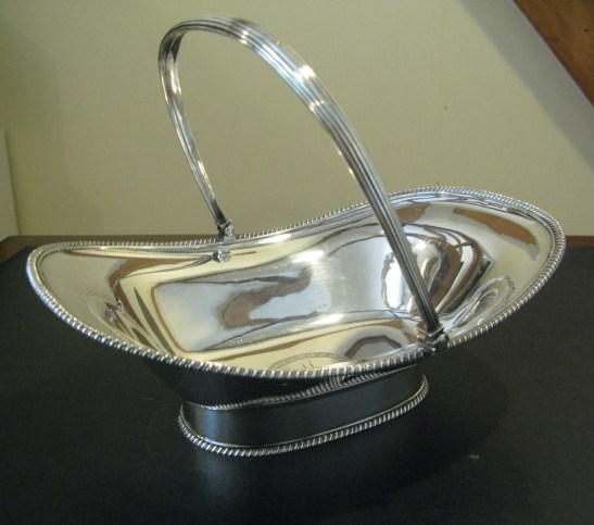 A silver cake basket with M monogram. LMF2009.2. Courtesy of Martha Madison Campbell.