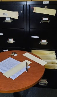 Once the room's inventory list is checked and the database is updated, the paper files are updated too.
