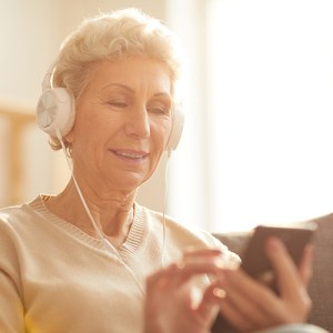 Woman listening to audio on her smartphone