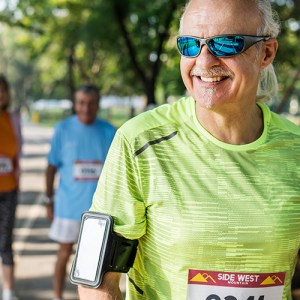 Male runner with smartphone strapped to arm