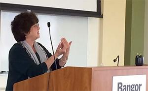 Susan Corbett at a podium