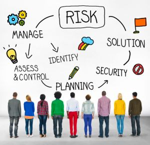 Image of nine men and women with their backs towards the viewer, looking at a lifecycle that says Risk - Solution - Security - Planning - Access & Control - Manage - Identify