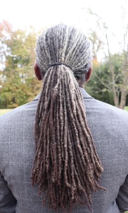 black man with grey locs