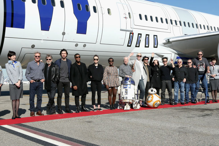 The Star Wars: The Force Awakens cast travel on a R2-D2 themed plane from Los Angeles to the London Premiere