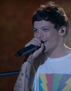Louis tomlinson during the  factor final also   debut single just hold on has topped uk rh digitalspy