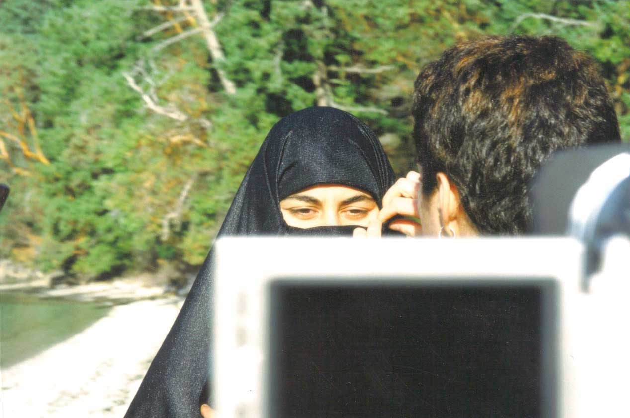 Youth participate in camerawork - one woman wears a niqab