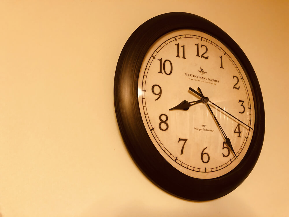 Time-tracking wall clock