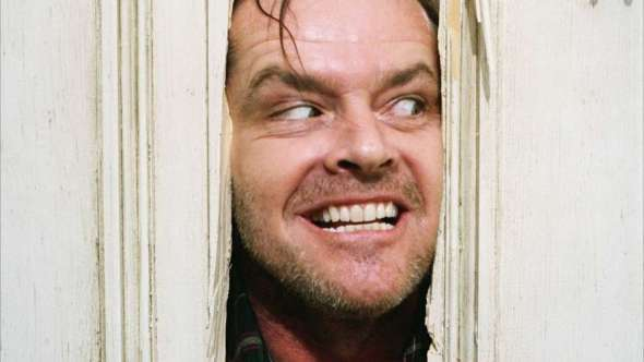 """Jack Nicholson's character in """"The Shining"""" busting through a door with a menacing grim"""