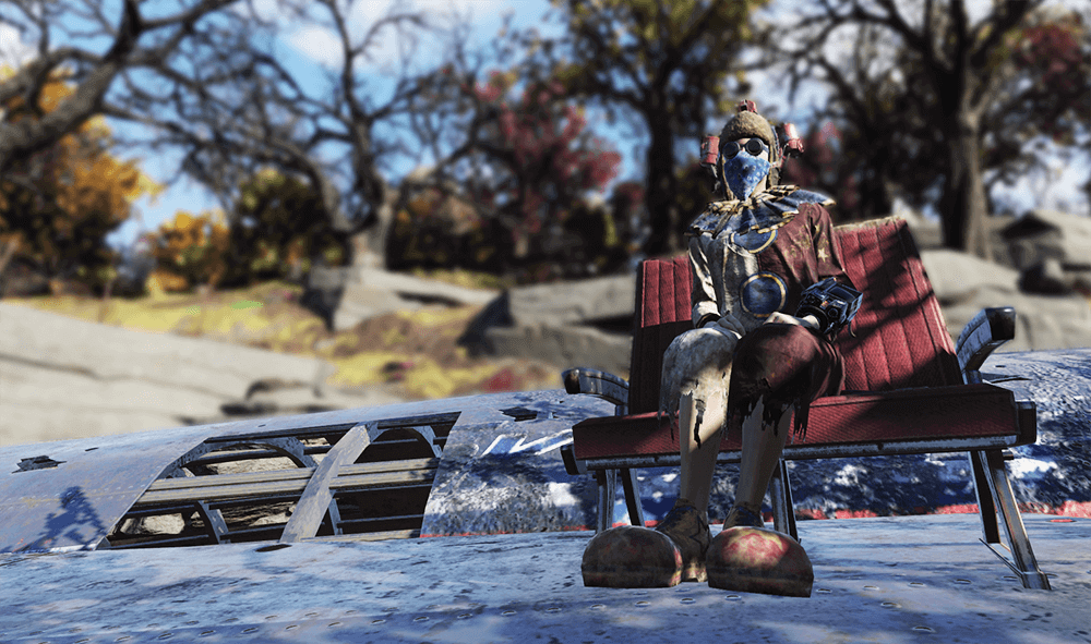A clown player in Fallout 76 sitting on a downed airplane