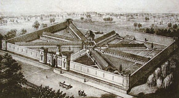 An old black and white etching of a large institutional building with a rectangular outer walls. Inside the rectangle, walls radiate to the outer wall from a central point like spokes on a wheel.
