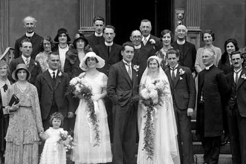 A wedding party standing on the steps of a court house