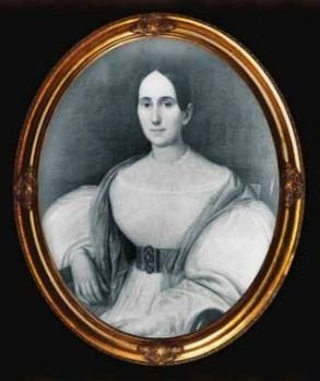 A drawing in a gold frame of a pale woman with dark hair and eyes wearing a white dress with large sleeves
