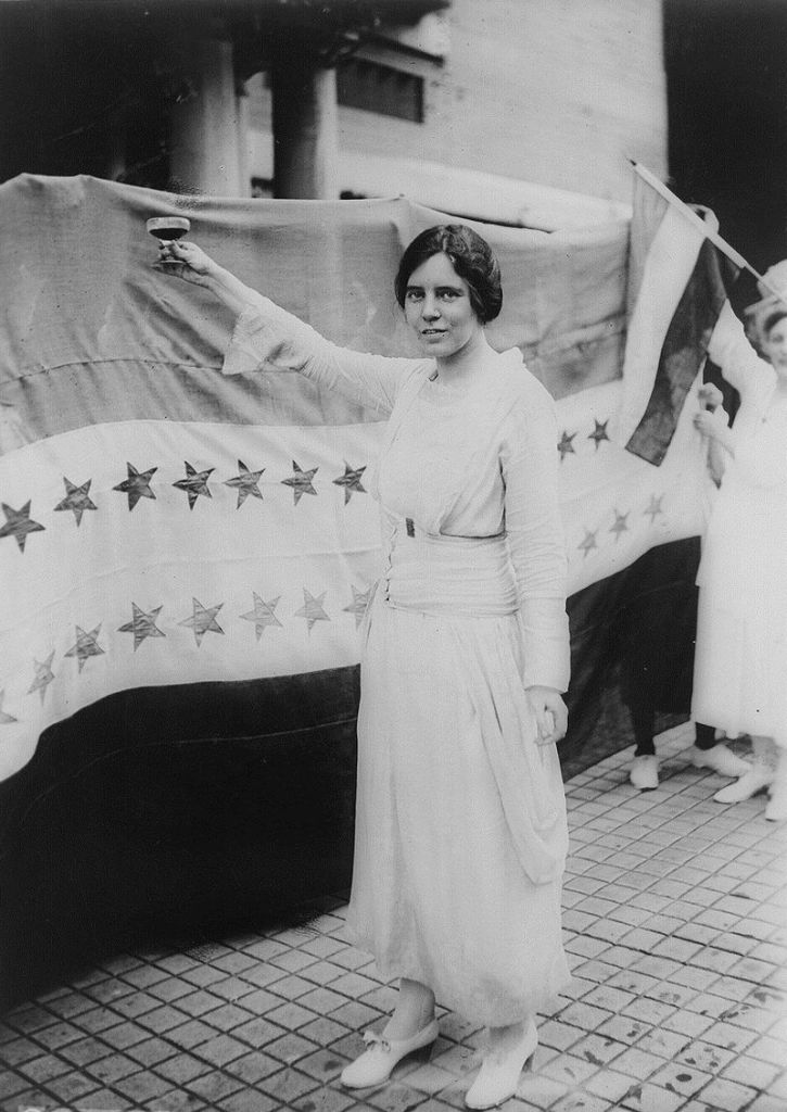 Alice Paul toasting the Nineteenth Amendment. Public Domain.
